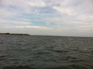 Open sea. Island tip in the distance.